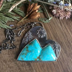 Artisan designed sterling silver turquoise pendant
